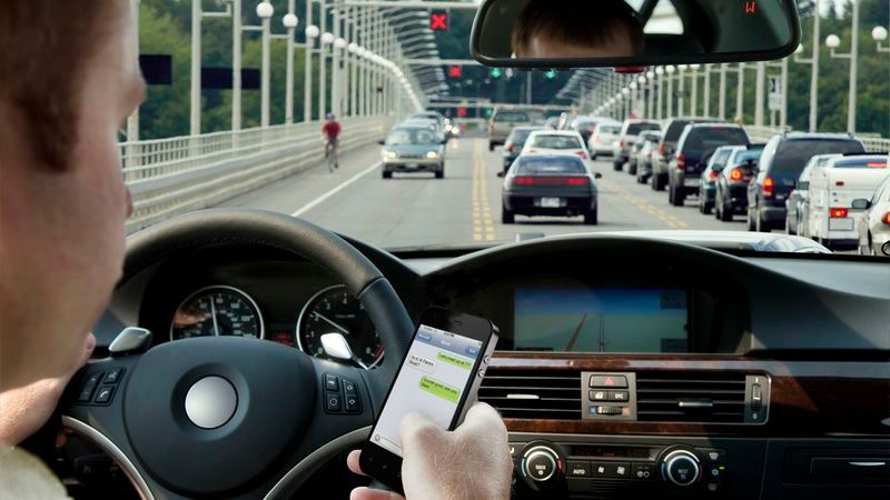 Distracted driving sending text messages while driving