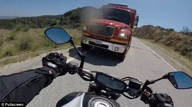 motorcycle dealing with trucks